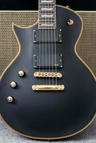 Left handed ESP LTD EC-1000 leaning against an amplifier