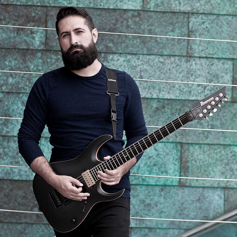 Jake Bowen of Periphery with signature Ibanez JBM100 guitar