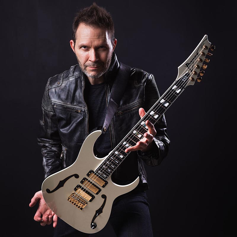 Paul Gilbert with Signature Ibanez PGM333 guitar