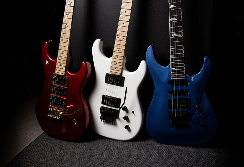 Three Kramer guitars; a Candy Apple Red Jersey Star, a Pearl White Pacer, and a Candy Blue SM-1