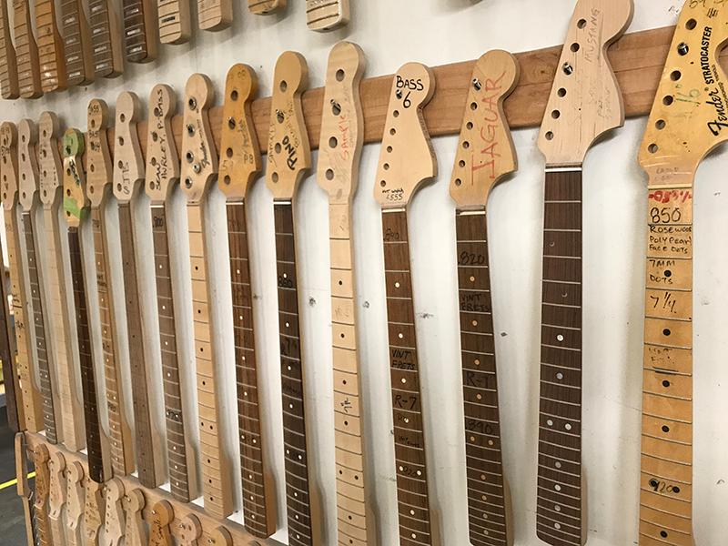 Fender necks lined up in the Fender Custom Shop